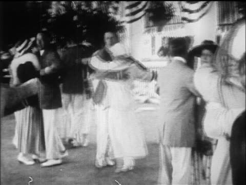 b/w 1915 pan couples dancing in outdoor pavillion / florida / newsreel - newsreel stock videos and b-roll footage
