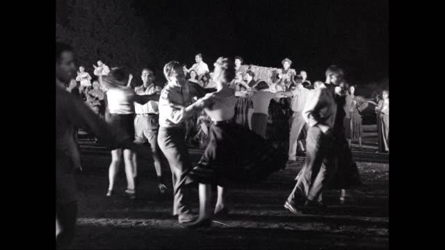 ws ts couples dancing near bonfire at night / israel - イスラエル点の映像素材/bロール