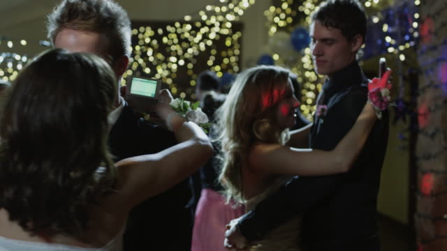 ms couples (14-15) dancing on prom night, girls text-messaging / cedar hills, utah, usa - high school prom stock videos and b-roll footage