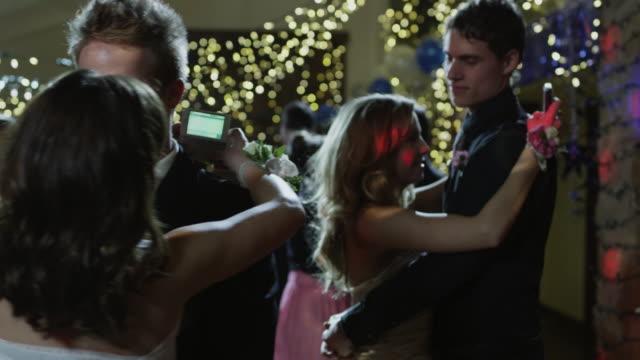 ms couples (14-15) dancing on prom night, girls text-messaging / cedar hills, utah, usa - 14 15 jahre stock-videos und b-roll-filmmaterial