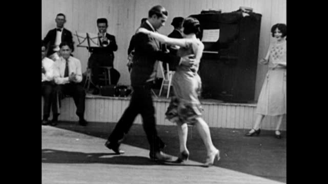 couples dancing the Charleston while musicians play in background People dancing the Charleston during Roaring 20s on January 01 1926 in Unspecified