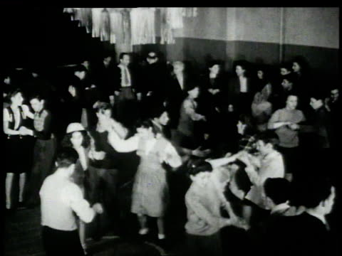 1946 ha couples dancing the jitterbug while other watch / new york, new york, united states  - 1946年点の映像素材/bロール