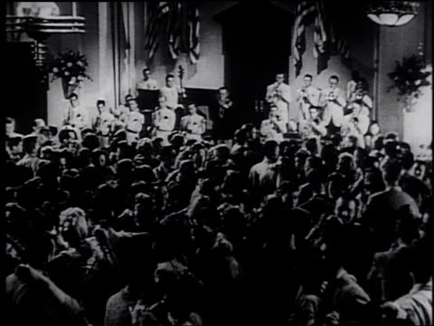 1945 montage couples dancing / united states - frank capra video stock e b–roll