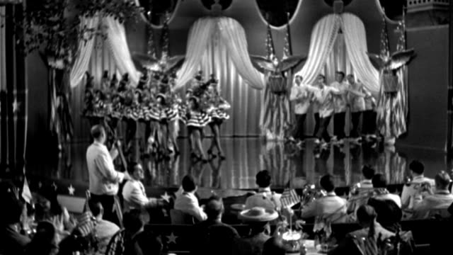 couples dine as a chorus line performs on a stage in 1941. - 1941 stock videos & royalty-free footage
