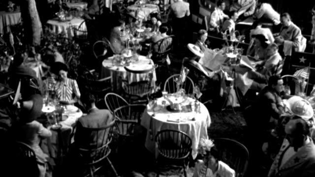 couples dine at round tables in 1941. - 1941 stock videos & royalty-free footage