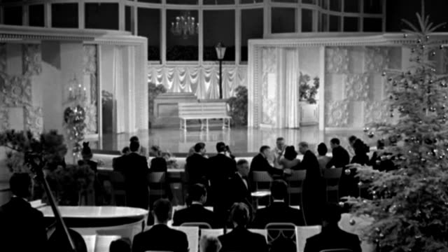 couples dine between an empty stage and an orchestra in a fancy nightclub. - 1941 stock videos & royalty-free footage