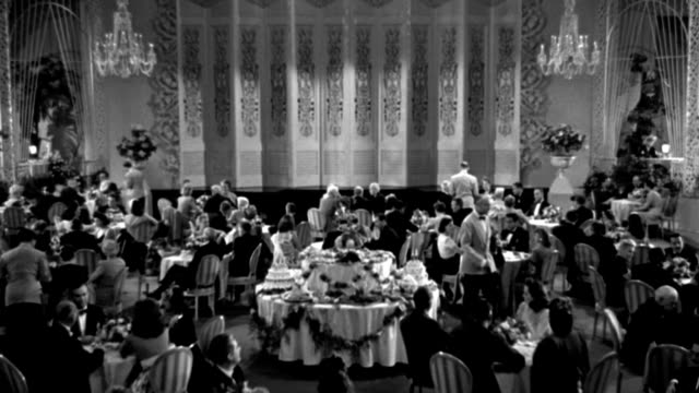 couples dine in an elegant dining room in 1944. - 1944 stock videos & royalty-free footage