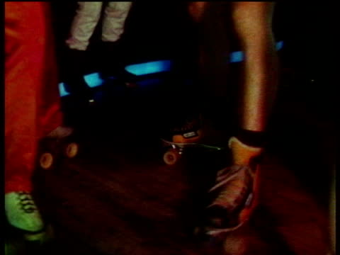 couples disco dancing on roller skates in nightclub / london, england - disco dancing stock videos & royalty-free footage