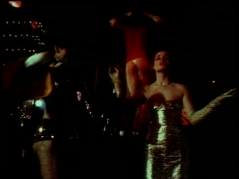 1979 MONTAGE HA WS MS TU LA Couples disco dancing on roller skates in nightclub / London, England