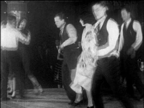 B/W 1925 couples doing Charleston dance at dance marathon / Roseland Ballroom, NYC / newsreel