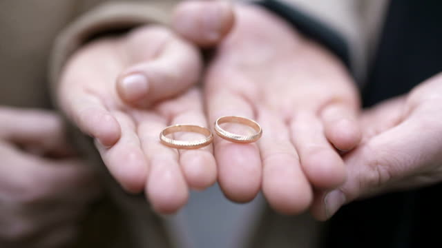 Couple's Hands Showing Engagement Rings