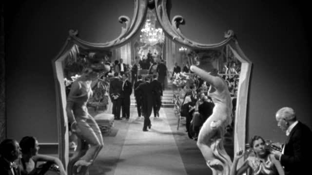couples in formal wear walk through a fancy casino in 1935. - 1935 stock videos & royalty-free footage