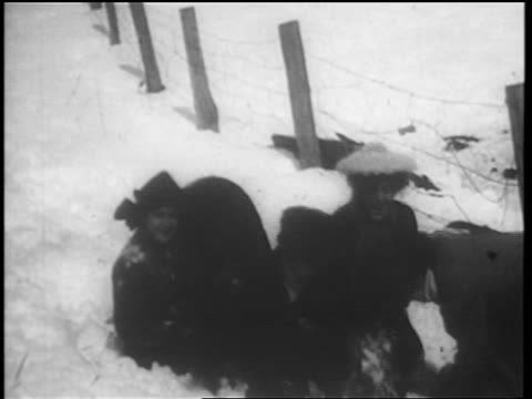 b/w 1904 2 couples laughing + wrestling in snow / winter - 1904 stock videos & royalty-free footage