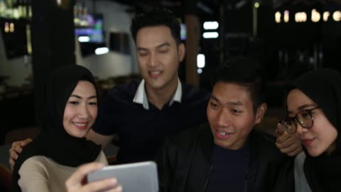 couples making selfie in cafe - malaysian culture stock videos & royalty-free footage