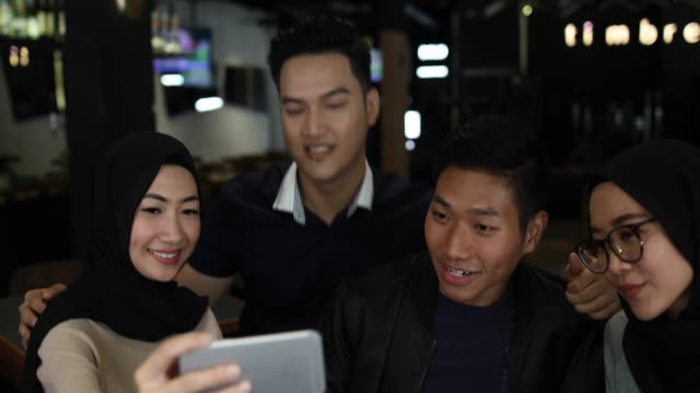 couples making selfie in cafe - malaysia stock videos & royalty-free footage