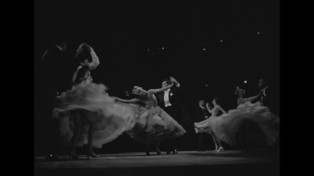 couples on stage dancing women in ball gowns full skirts swirl / ms couple with swirling skirt / polka dancers in traditional costumes / ball room... - polka dancing stock videos & royalty-free footage
