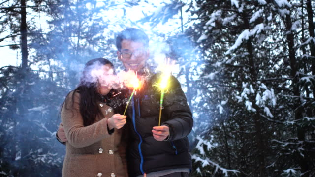 Couples playing with fireworks
