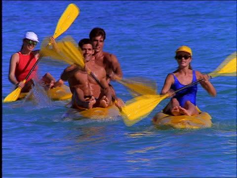 vidéos et rushes de 2 couples racing in kayak-like boats on ocean / cancun - kayak sport