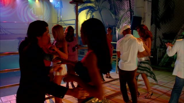 couples salsa dance in a nightclub. available in hd. - salsa stock videos & royalty-free footage