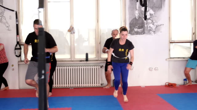 couples training together - male with group of females stock videos & royalty-free footage