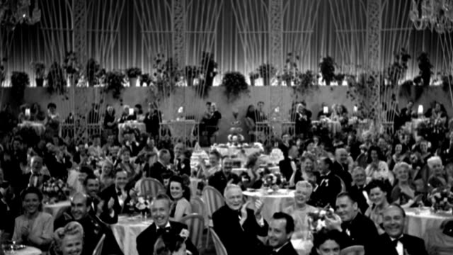 couples watch a performance in an elegant dining room. - 1944 stock videos & royalty-free footage