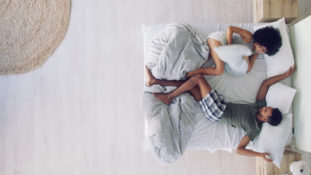 couples who play together stay together - bed furniture stock videos & royalty-free footage
