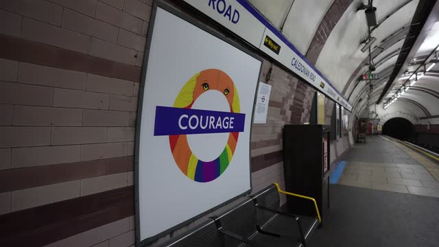 """courage"""" by edwin, customer service assistant at caledonian road london underground station at tfl installs new equality signs across london... - business finance and industry stock videos & royalty-free footage"""