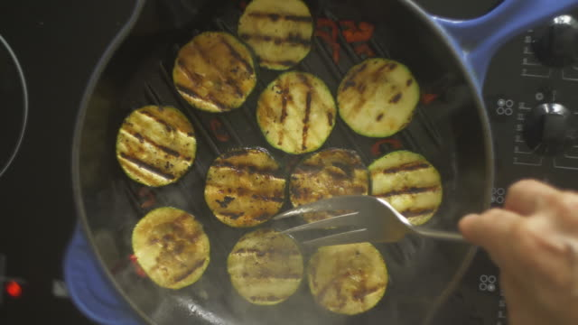 courgettes zucchini frying - meal stock videos & royalty-free footage