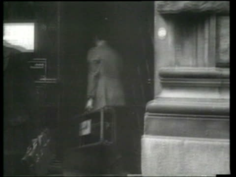 stockvideo's en b-roll-footage met courier delivers adolph hitler's mementos and keepsakes to a bavarian bank in munich. - bbc archives