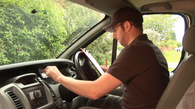 courier / delivery man with gps / sat nav - van vehicle stock videos and b-roll footage