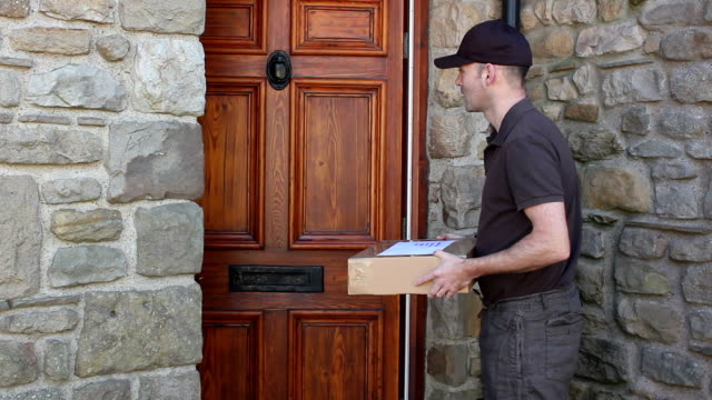 courier home delivery parcel at house - shipping, logistics deliveryman - package stock videos and b-roll footage
