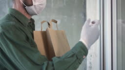 Courier is delivering the ordered products home to the customer during pandemic