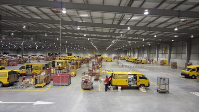 t/l ws ha couriers collecting packages into vans at courier center, auckland, new zealand - efficiency stock videos and b-roll footage