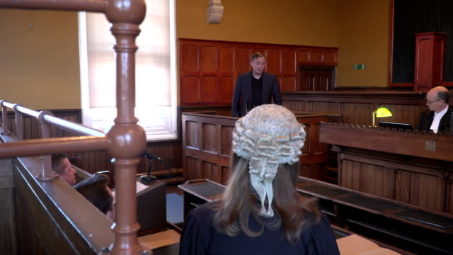 4k dolly: court case - female barrister questioning witness - court hearing stock videos and b-roll footage