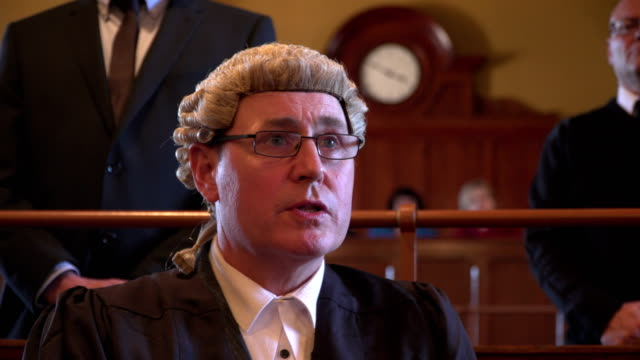 4K: Court hearing - Male Barrister questioning Witness