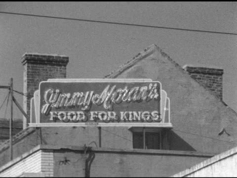 stockvideo's en b-roll-footage met ms 'court of two sisters restaurant' hanging sign famous iconic creole historic neighborhood - rue royale