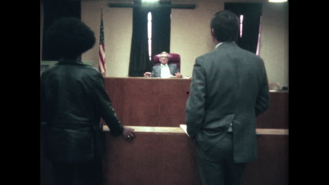 court proceeding - woman and lawyer before judge - giudice video stock e b–roll