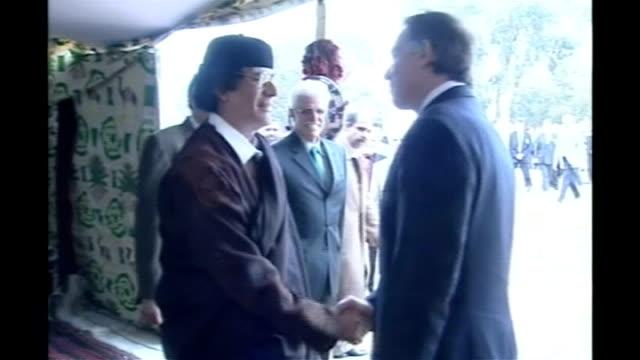 court rules against deportation of abu qatada lib nr tripoli photography** tony blair mp along to shake hands with libyan leader colonel moammar... - muammar gaddafi stock videos & royalty-free footage