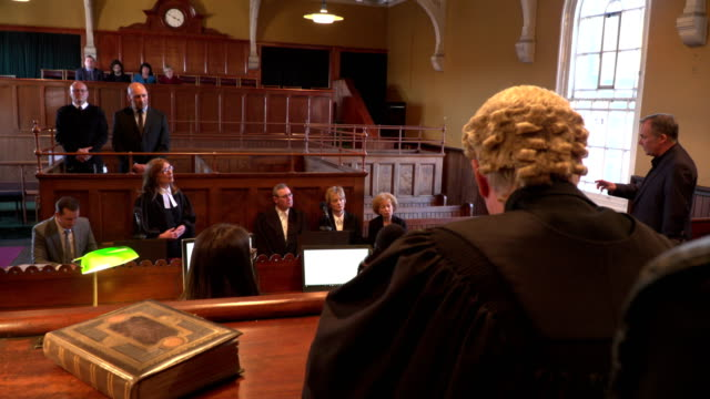4k: courthouse - court case with judge & lawyer / barrister - court hearing stock videos and b-roll footage