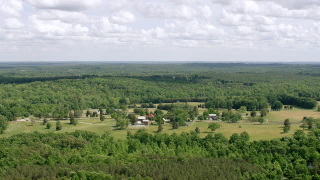WS AERIAL POV Courthouse surrounded by forest area at Courthouse National Park / Appomattox, Virginia, United States