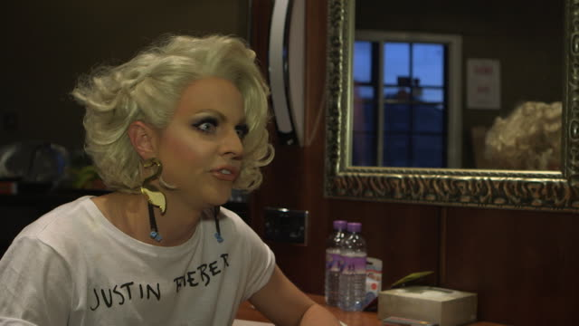 interview courtney act talks about the public perception of drag female fans younger fans saturation point campuses in the uk and australia boy... - paul o'grady stock-videos und b-roll-filmmaterial