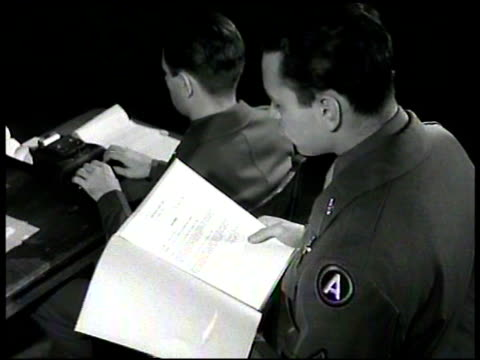 courtroom audience ms us military commission ha ms clerk reading charges stenographer ms german nazi franz strasser sitting ms military man taking... - gerichtsverhandlung stock-videos und b-roll-filmmaterial