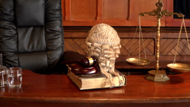 4k dolly: courtroom bench with barrister / judge wig - courthouse stock videos and b-roll footage