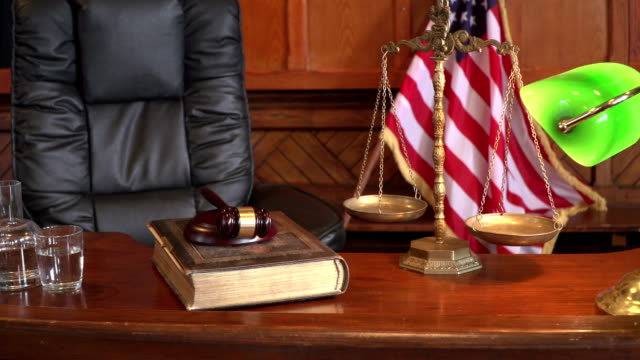 4k dolly: courtroom bench with usa flag - law stock videos and b-roll footage