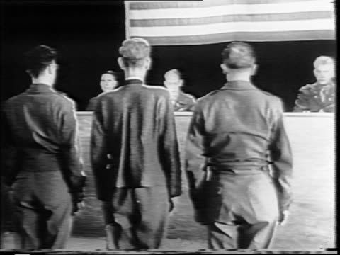 courtroom standing as judges enter the courtroom / rear view of courtroom as everyone sits / nazi prisoner franz strasser standing before judges / a... - lady justice stock videos and b-roll footage