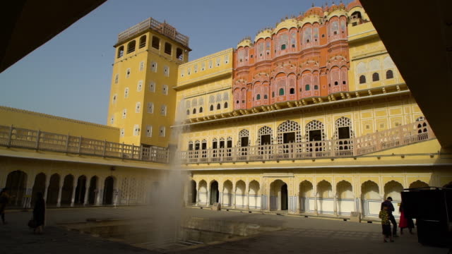 courtyard at the hawa mahal with active fountain. - mughal empire stock videos and b-roll footage