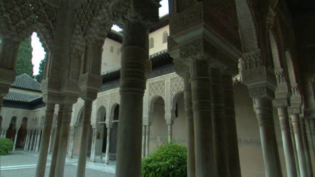 ms, pan, courtyard colonnade in alhambra palace, granada, andalusia, spain - colonnade stock videos & royalty-free footage