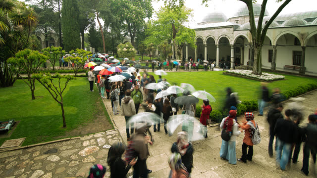 t/l zo ws courtyard of topkapi palace in istanbul, turkey with umbrellas - topkapi palace stock videos and b-roll footage