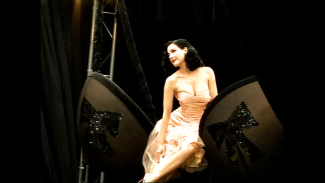 ** BEWARE Dita von Teese posing on stage at launch of underwear range