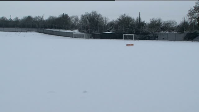 aron gunnarsson in snow england coventry ext view of coventry city training ground in snow aron gunnarsson fc keeping up football in snow - coventry stock videos & royalty-free footage
